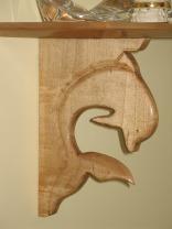 carpentry-dolphin-shelf-closeup